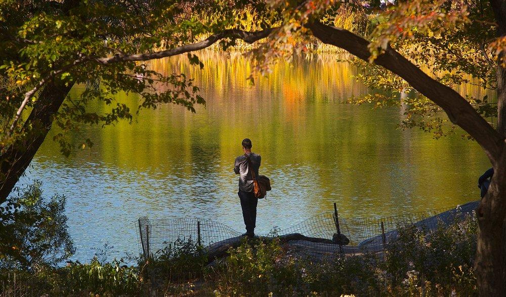 photo-man-pond-reflections.jpg