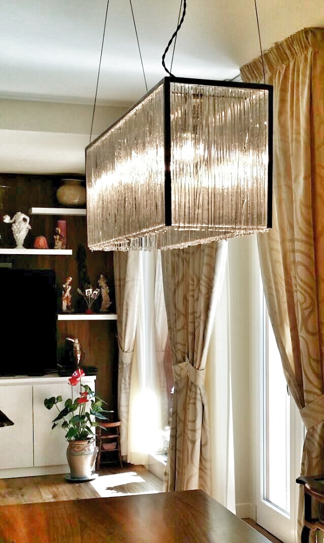 Big hanging glass lamp. Interior.