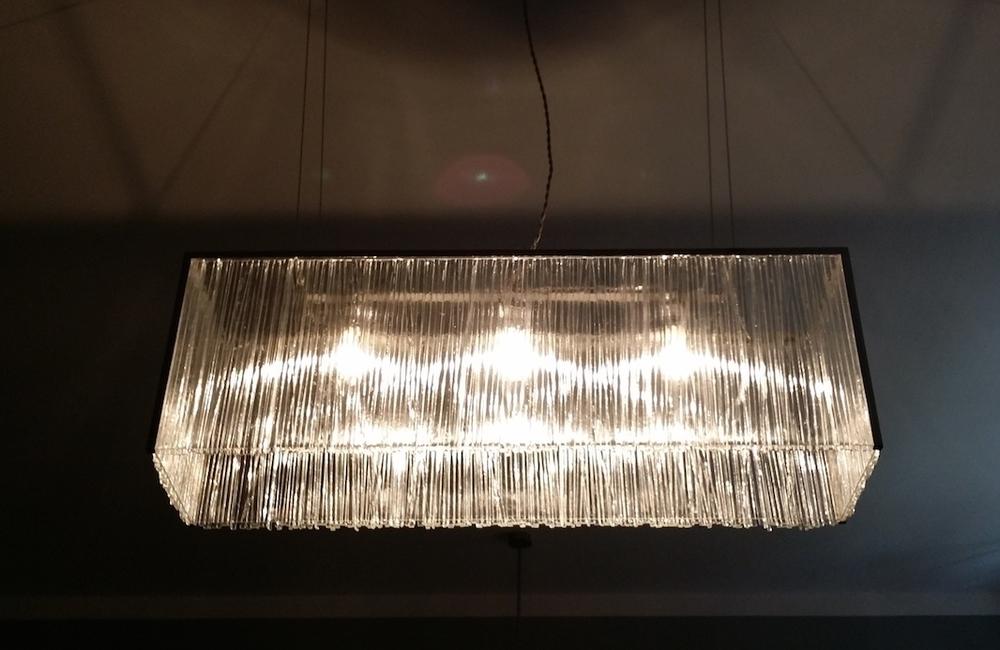 Big hanging glass lamp. Night effect.