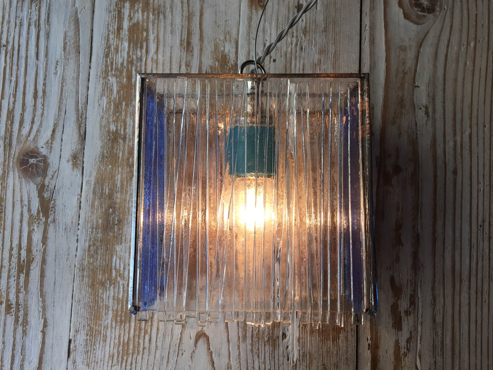 Shades of blue. Wall glass lamp.