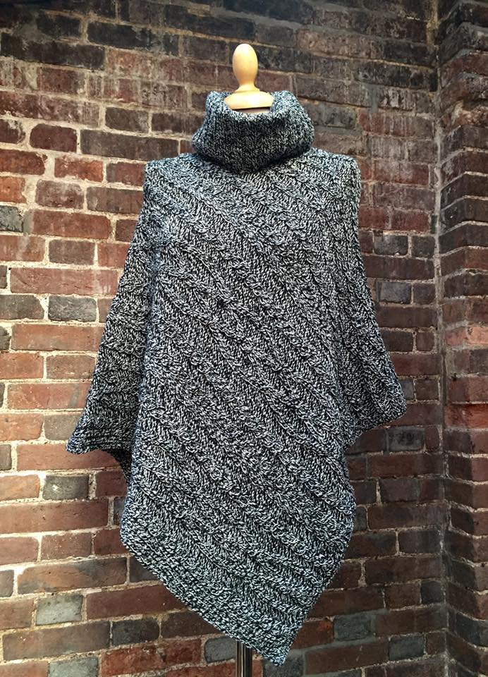 Barley Poncho (Charcoal) 69.00 Made from 100% Merino wool, the chunky 5gge Aran cable Poncho features a roll neck fastened with buttons, perfect for layering and styling with other knitwear pieces. A transitional style designed to drape effortlessly during all seasons.