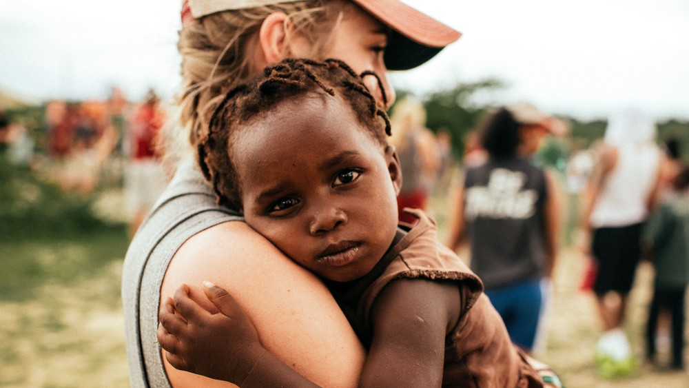 Christian Missionary Holding Child Religious Stock Photo.jpg