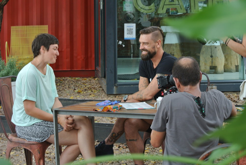 Brett interviewing Lucy at Freedom Cafe.JPG