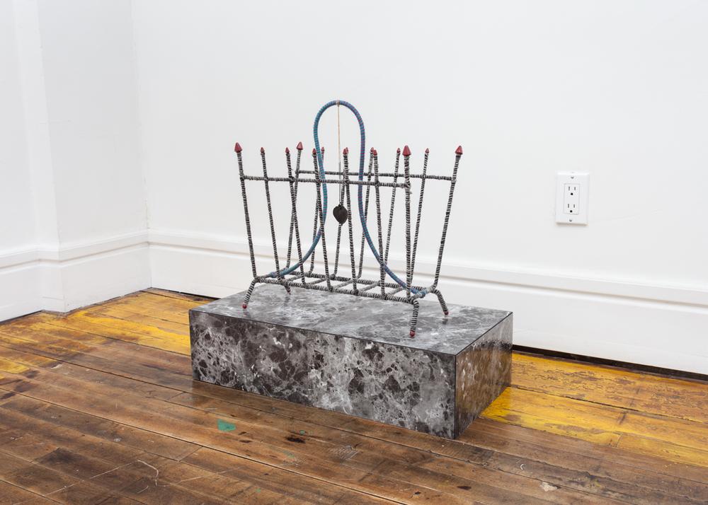 "Look Wanting Artisan  12"" x 24"" x 20"", wire magazine stand, yarns, One Shot enamel, a necklace my mother once wore to a funeral, and linoleum, 2015"