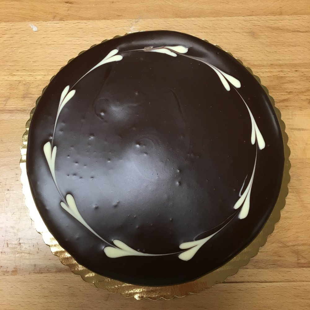 Chocolate lovers dream.  Rich, dense, and extra chewy cake, topped with a layer of our famous dark chocolate mousse, and finished with dark chocolate ganache glaze.