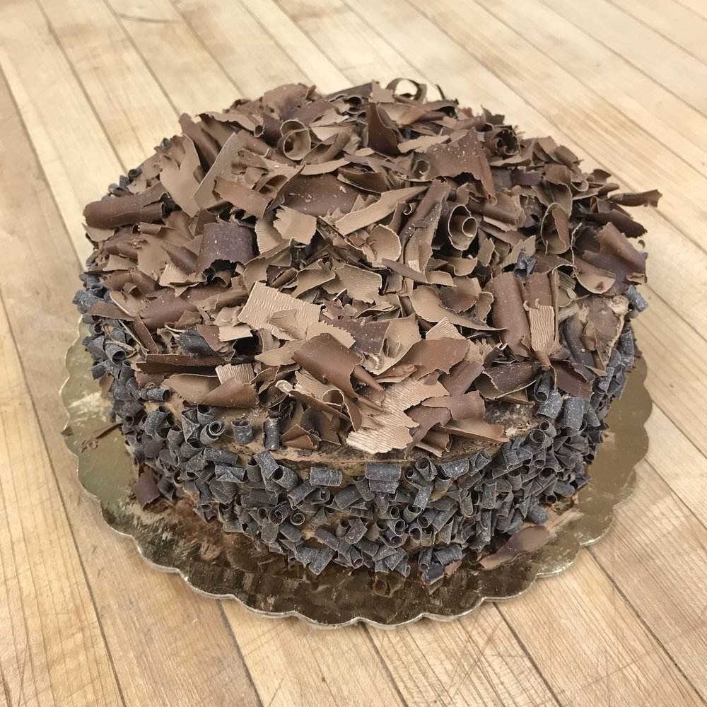 Semi-sweet chocolate layered between discs of chocolate cake and finished with chocolate shavings.