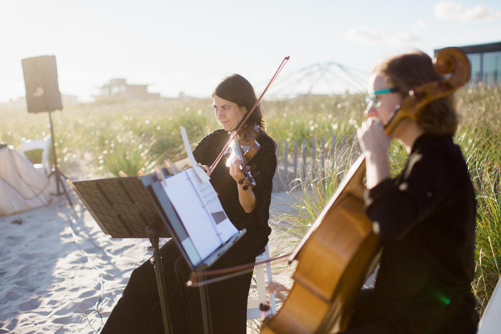 Photo of Luminous Sounds playing for a beachfront ceremony by Katie Kett Photography