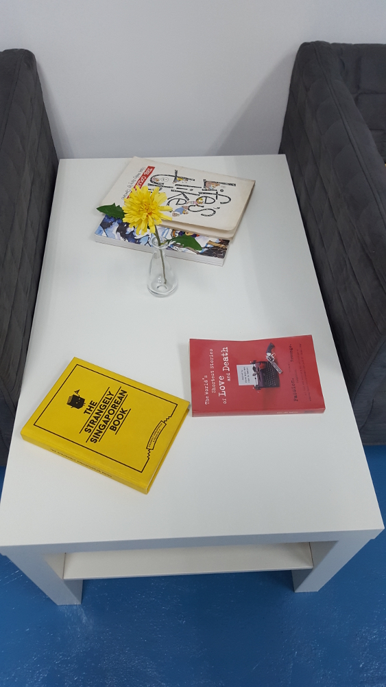 LACK sidetable, $24.90.  Flower and jar sold separately, books not included.