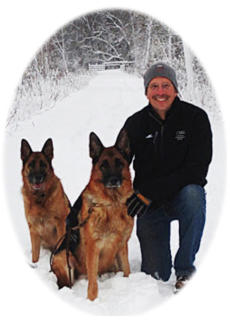 Dr. Scott Spaulding with his German Shepherds, Jeck and Qira
