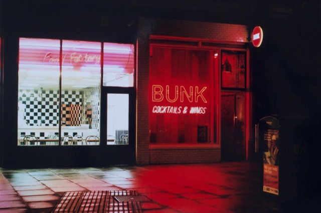 BUNK. Neon at night.