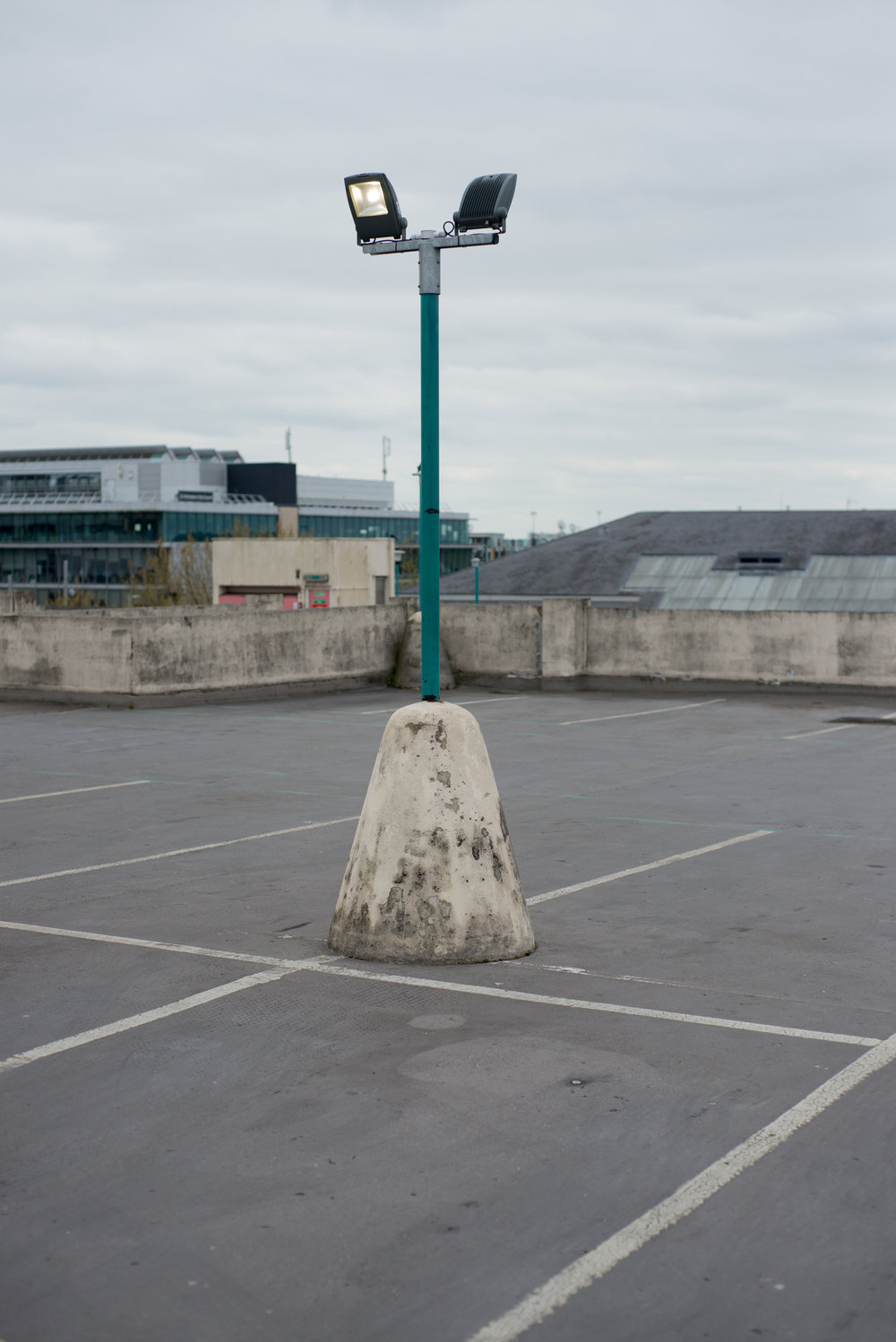 A street lamp on top of a car park in Nottingham.