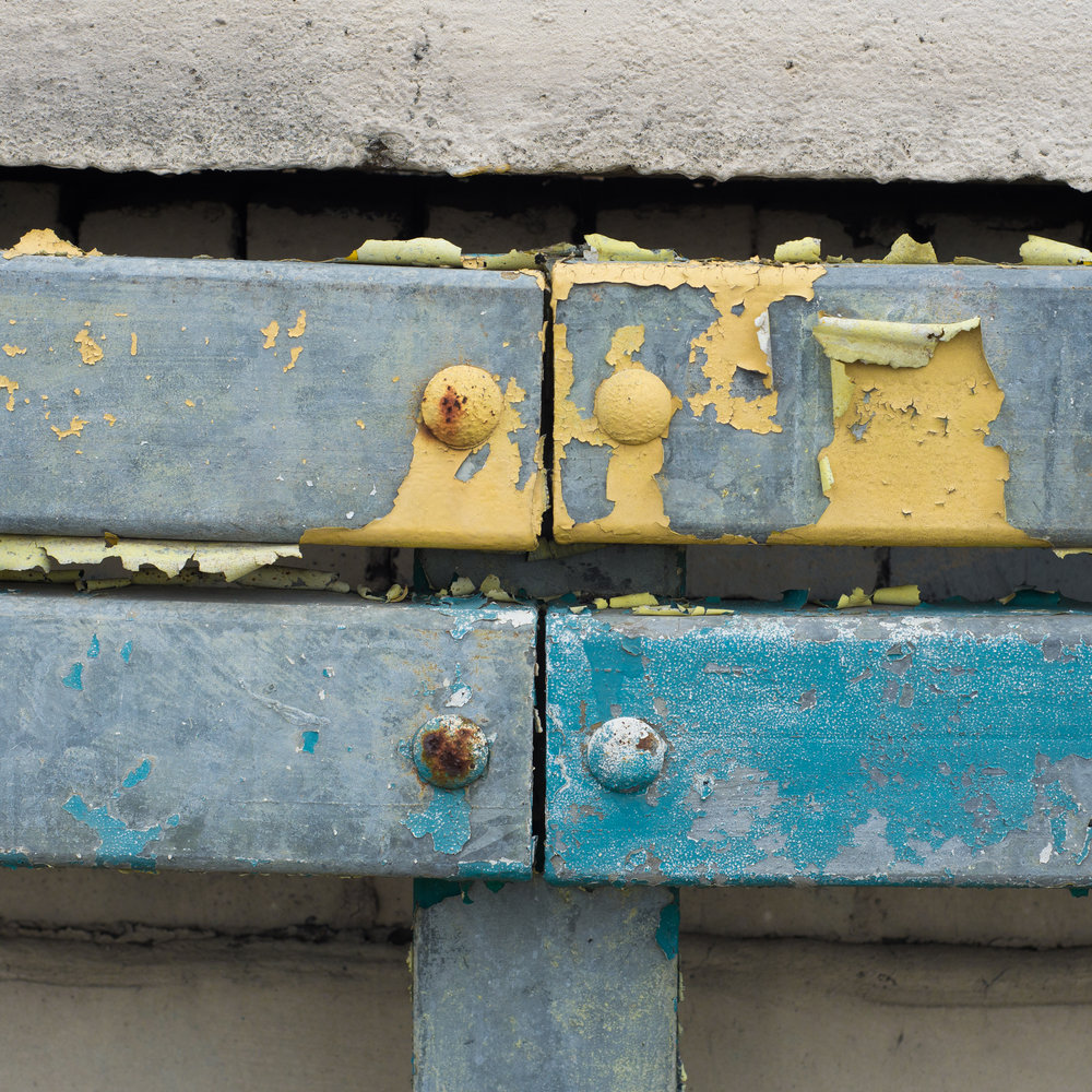 A close up photography of chipped-paint railings.