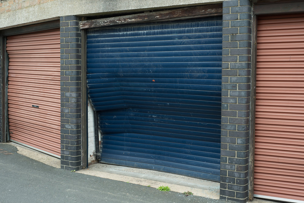 A dented garage door in Nottingham, England.