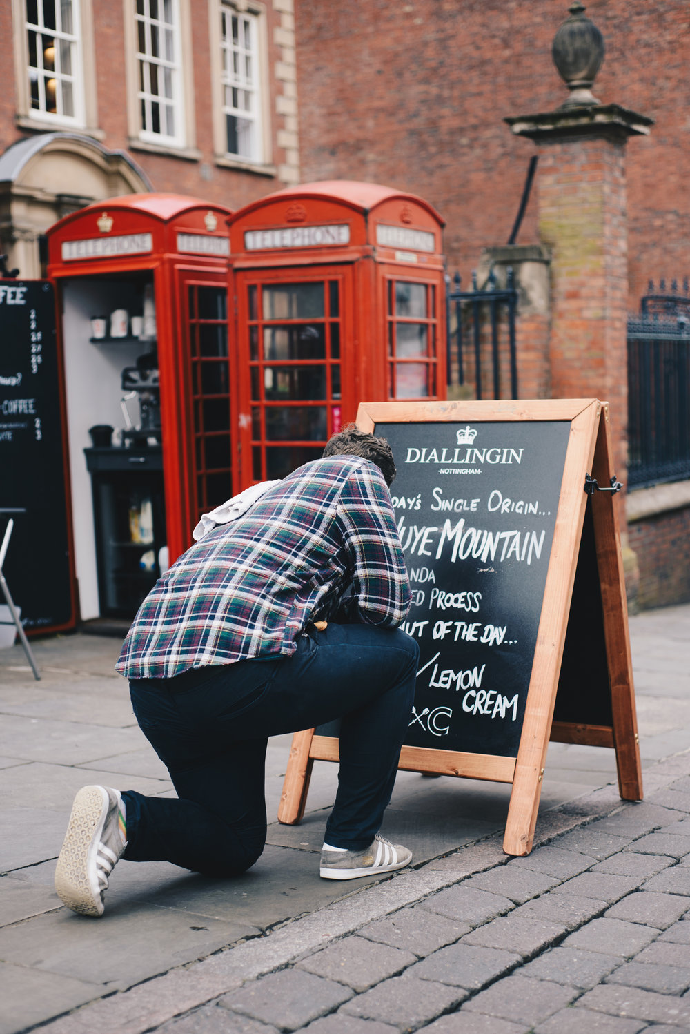 Luke prepares the day's sign during our photoshoot in Nottingham.