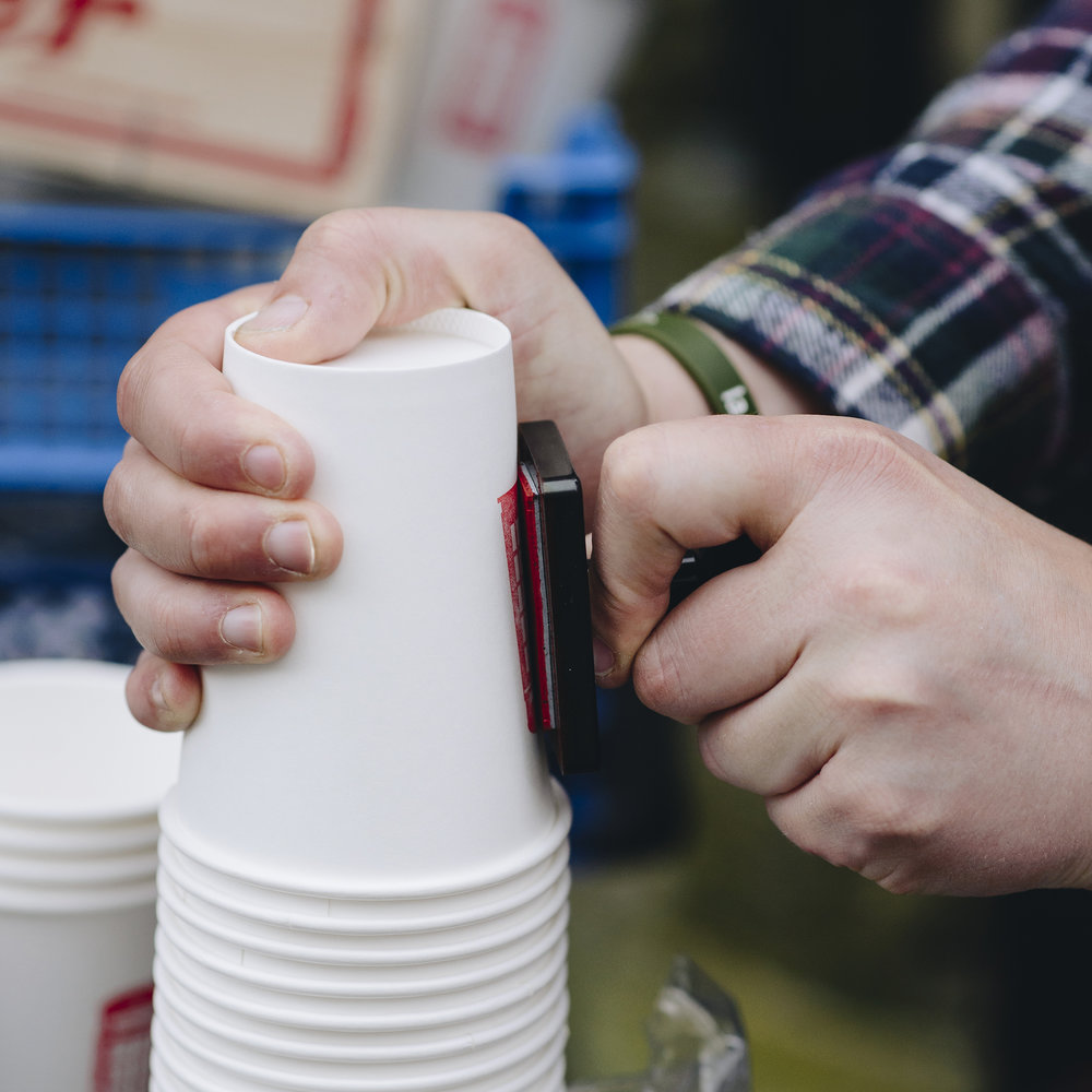 Hand-stamping each coffee cup is a vital part of Luke's daily routine.