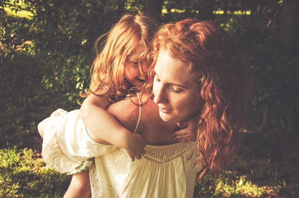 redhead mommy and daughter playing in the woods california lifestyle photography