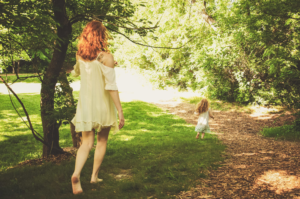 Redhead mom and daughter running in the woods California lifestyle family photography