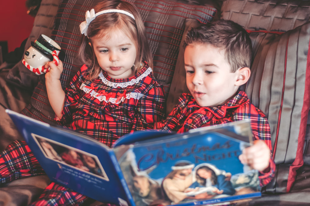 Laguna Hills Christmas photo shoot with little boy and little girl reading