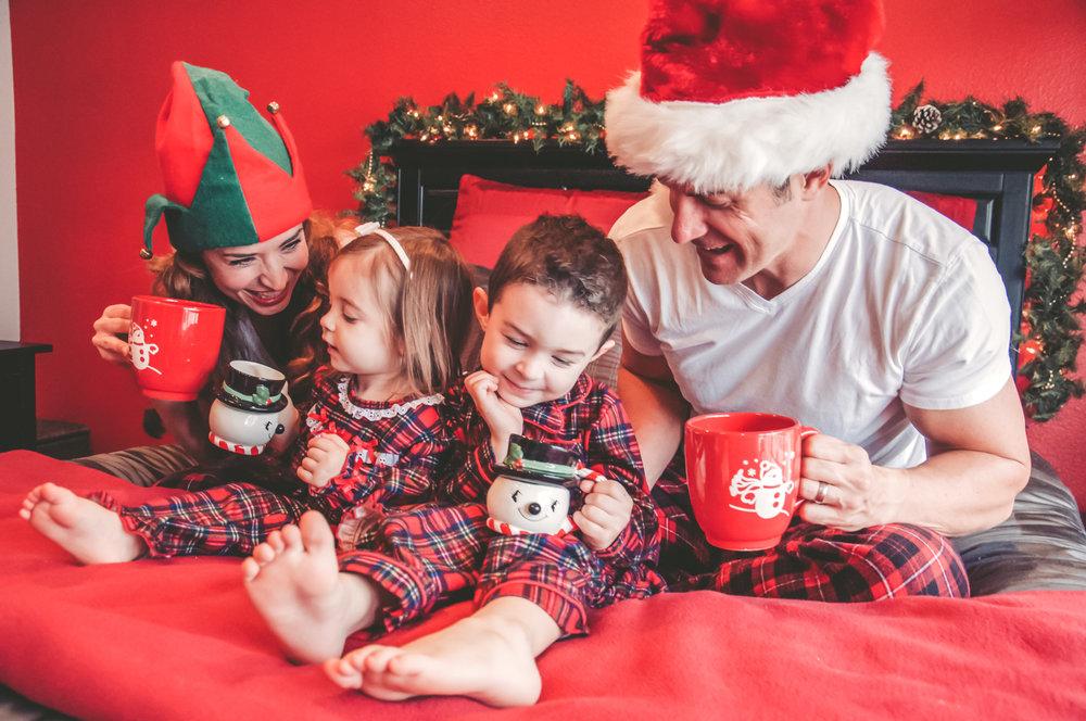 laguna hills christmas themed family photo shoot in home drinking hot cocoa