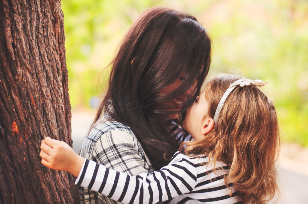 hollywood mom and little daughter sharing a kiss in west hollywood
