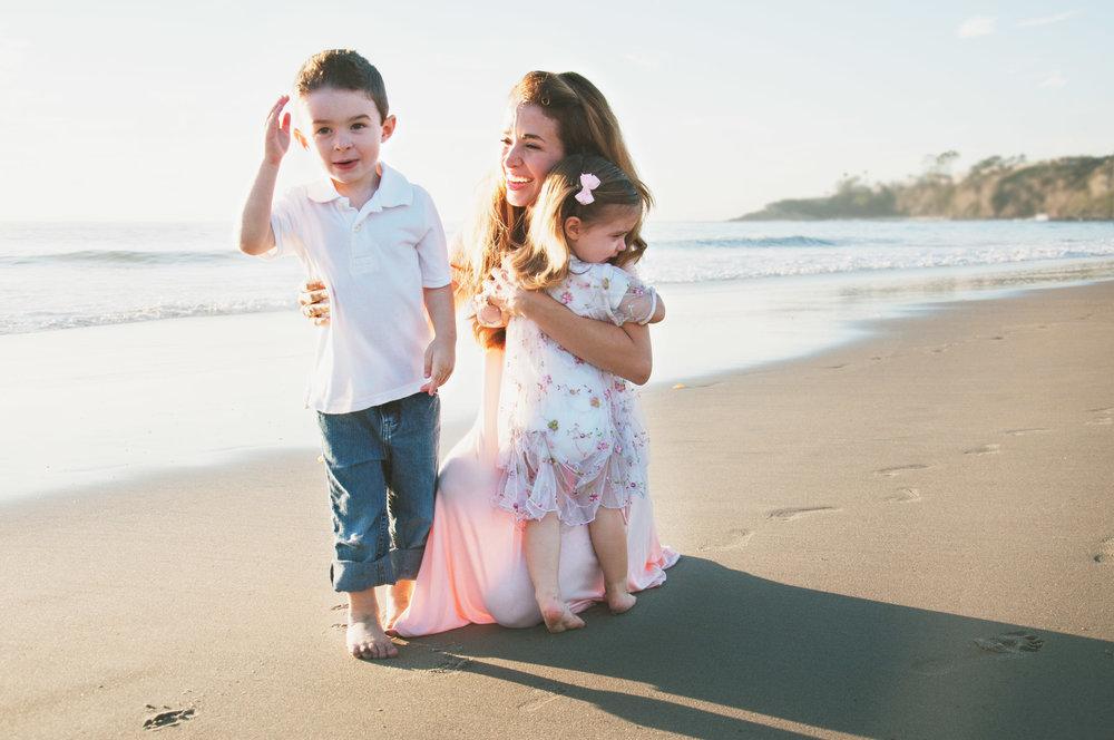 mommy hugging little girl and little boy by the ocean velvet violet photography