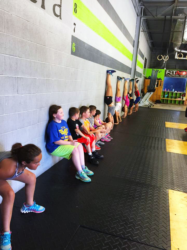 CrossFit-Mantra_CrossFit-Kids_Wall-Sits-and-hand-stand-push-ups.jpg