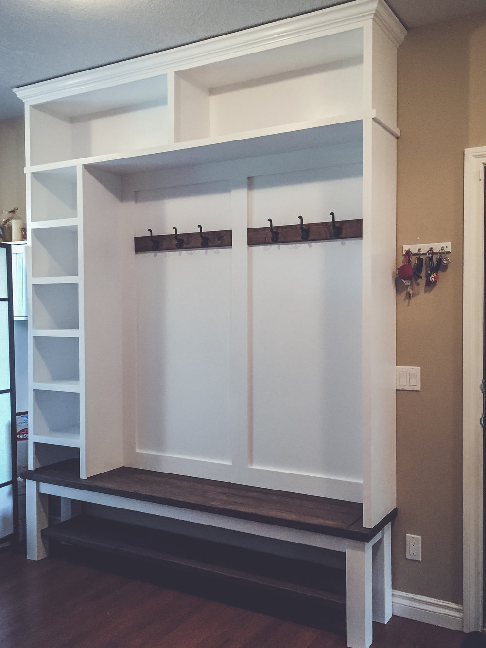 Over 8 ft tall! - Side cubbies help with organizing seasonal wear.