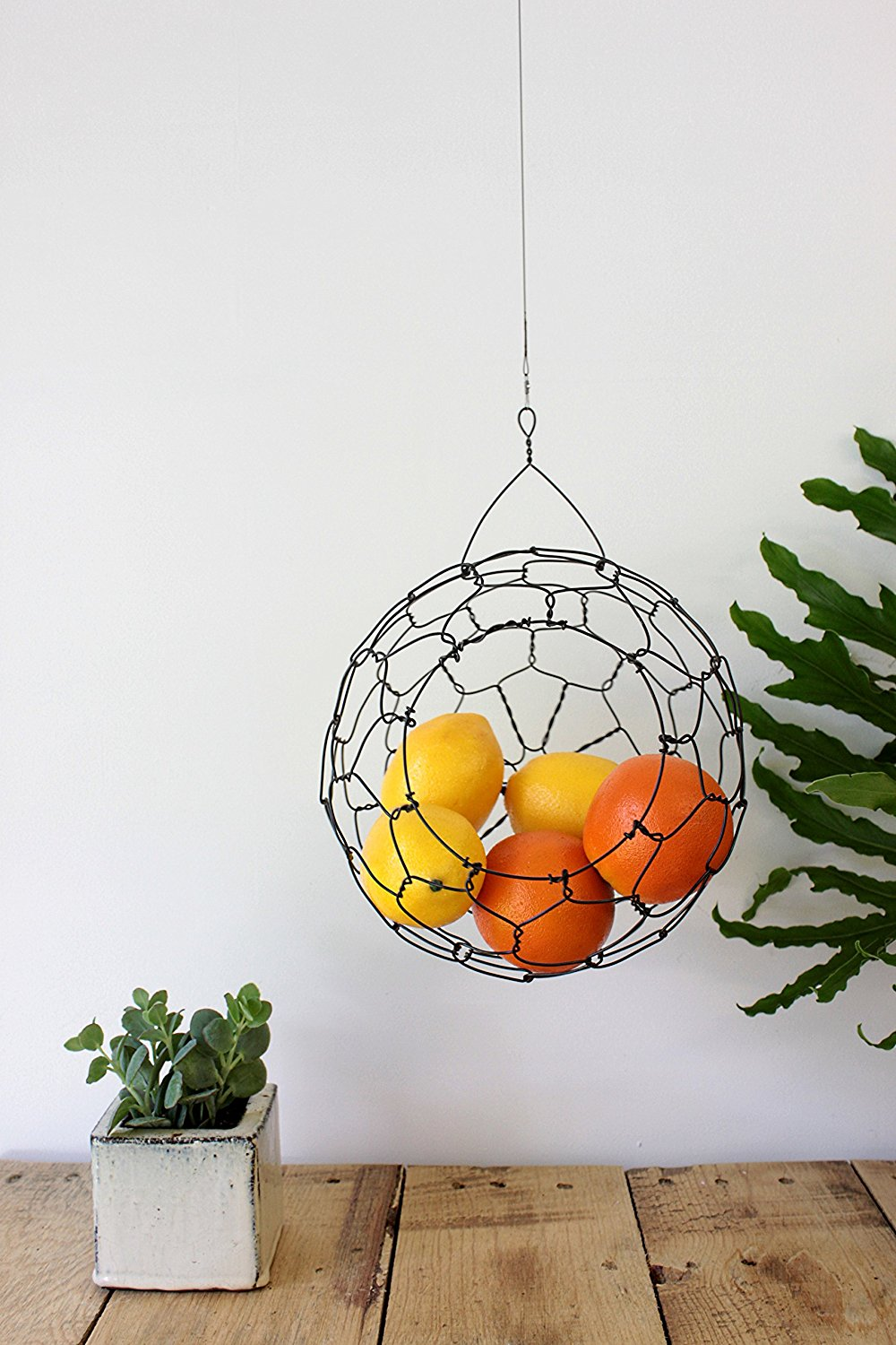 9. Decorative Hanging Baskets - I LOVE this hanging fruit basket. It is just as much decor as it is functional storage. I'm have one and painted it brass to match the rest of my kitchen! I keep citrus fruits in it just like this picture. It is so beautiful!