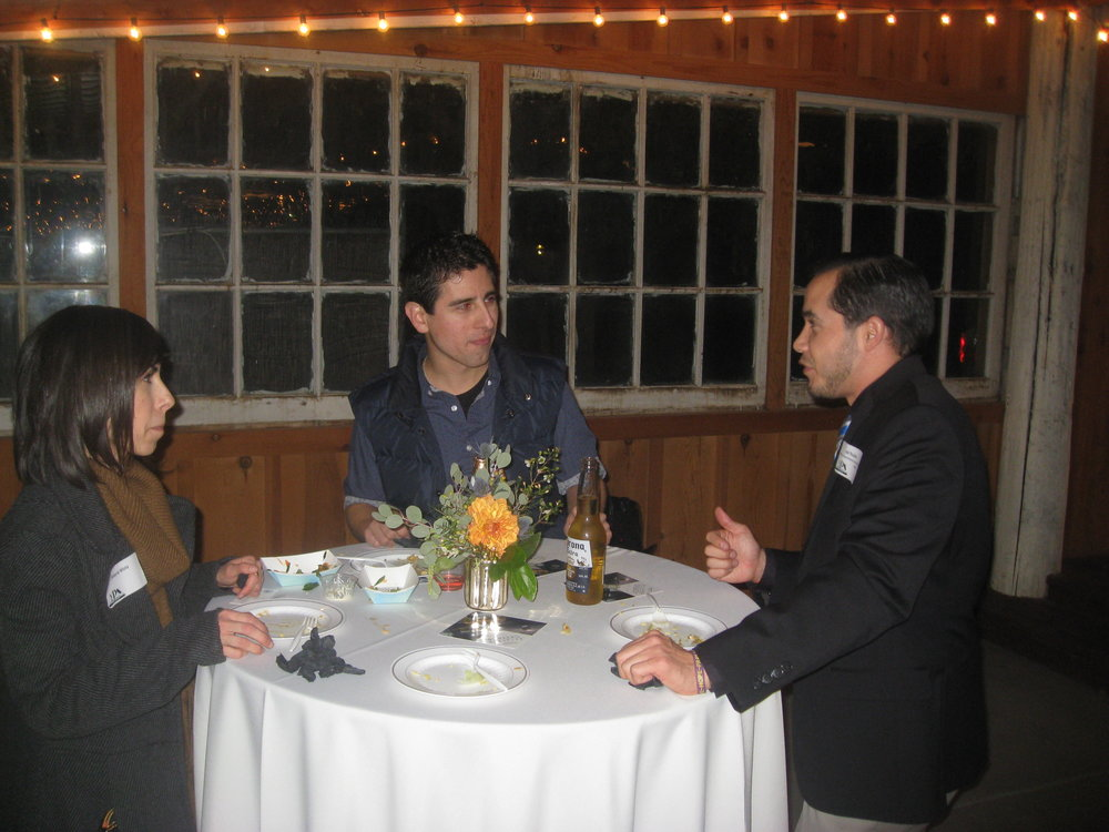YPN Committee member Joel Rosales makes a new connection with Valerie & Luis Mota during the YPN Mixer on January 22nd.JPG