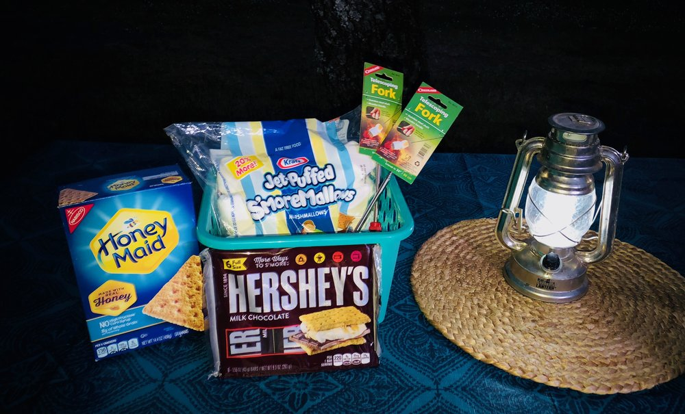 S'more Package - Complete your camping experience with a custom s'more kit that will be prepared and ready when you pick up your teardrop. Kit includes: 2 telescoping s'more forks, 1 bag of marshmallows, 1 package of 6 Hershey bars and a box of graham crackers $25.00 per kit **Add to you cart when you reserve a trailer**
