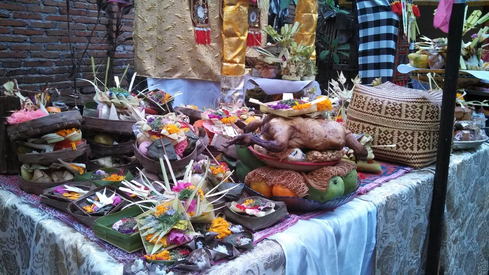 So many offerings of cakes, fruit, flowers, rice and chicken.