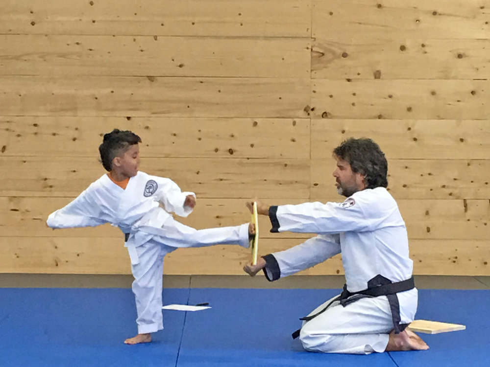 One of our youngest students breaking a board for his Orange Belt test!