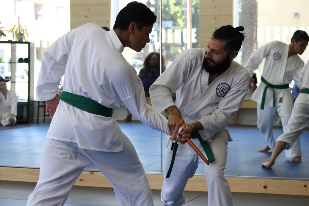 Demonstrating knife-defense technique