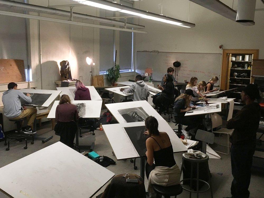 Students choose between three drapery still-life sets ups and make a reductive charcoal drawing.