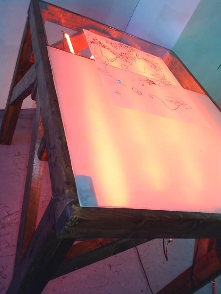 Light Table, 2005. Mixed media: wood, glass, neon, converter, electronics.