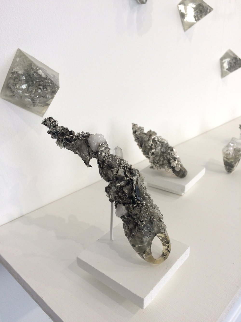 Chloe Lewis -  Impacts of Climate Change  (Pewter, resin, glass, sterling silver, electro-formed silver and natural materials)