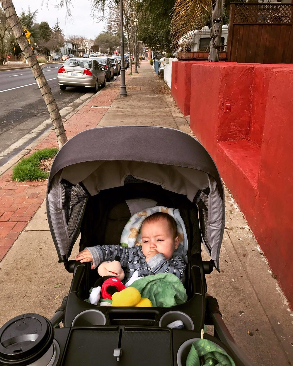 photo of baby in stroller in downtown Morgan Hill