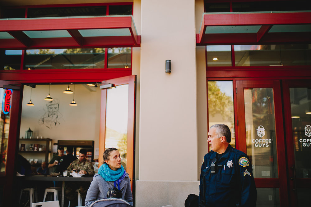 Ewa Samples talking to MHPD officer outside of coffee guys in Morgan hill California