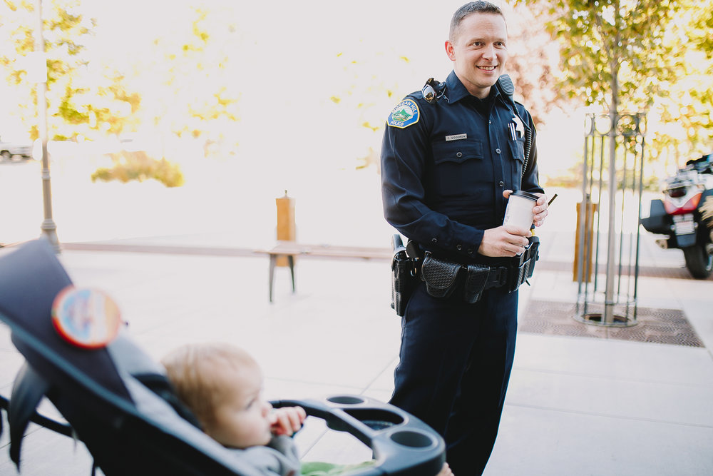 Archer Williams, a baby, talking to Morgan Hill police officer in downtown Morgan hill at coffee guys