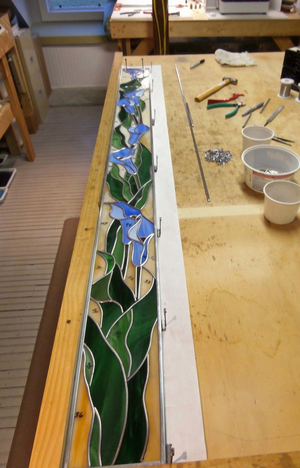 Finished leading and added the zinc borders.