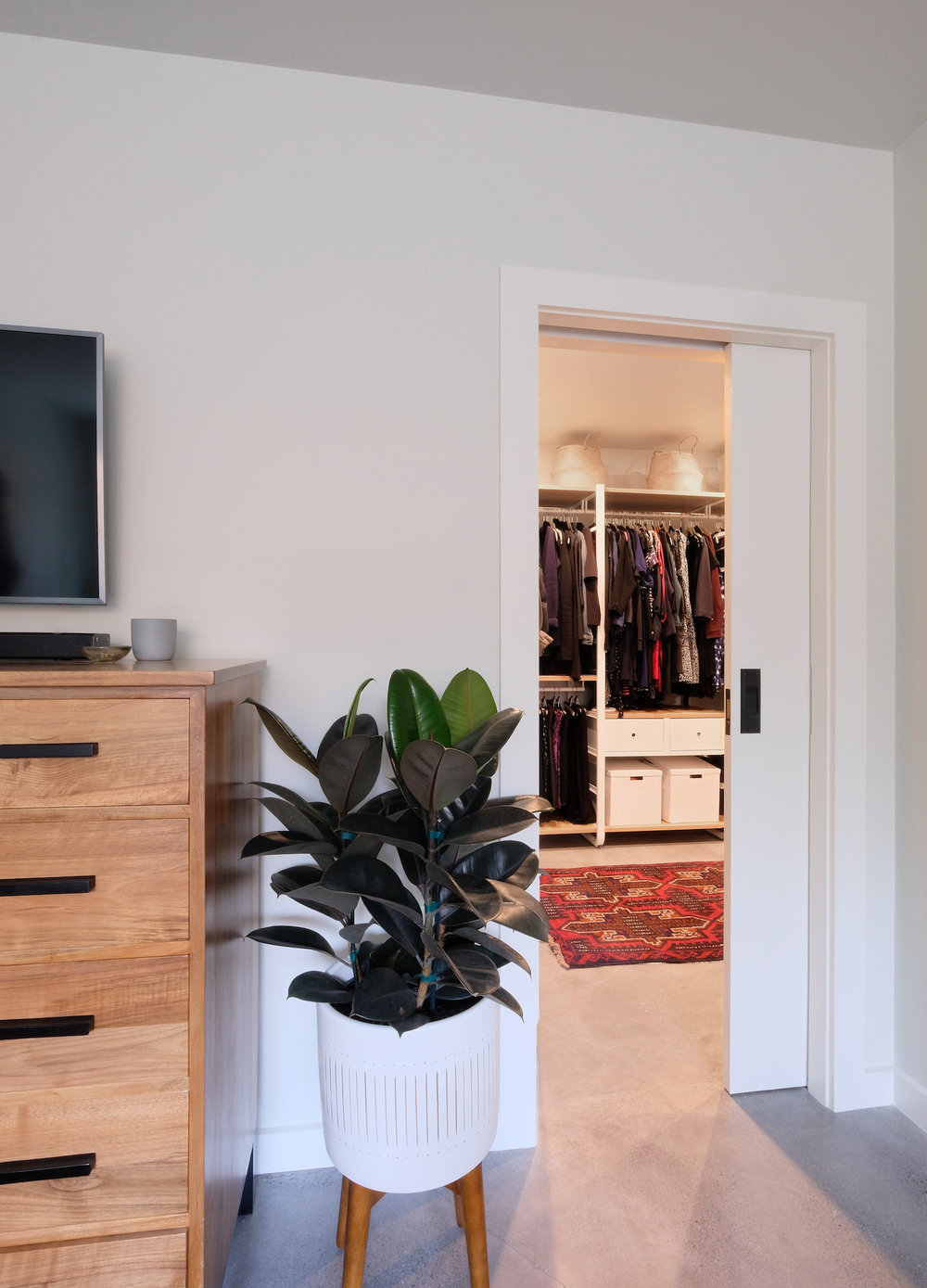 closet entry with pocket door and cement floors.jpg