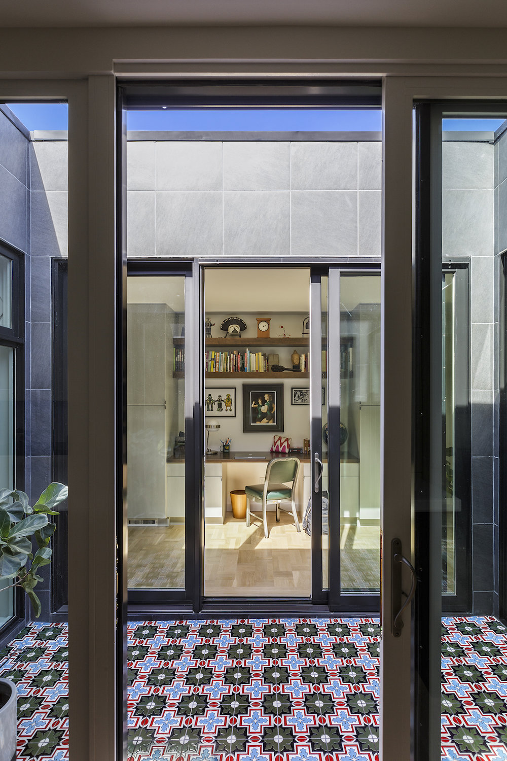 atrium space with mosaic tile and sliding doors.jpg
