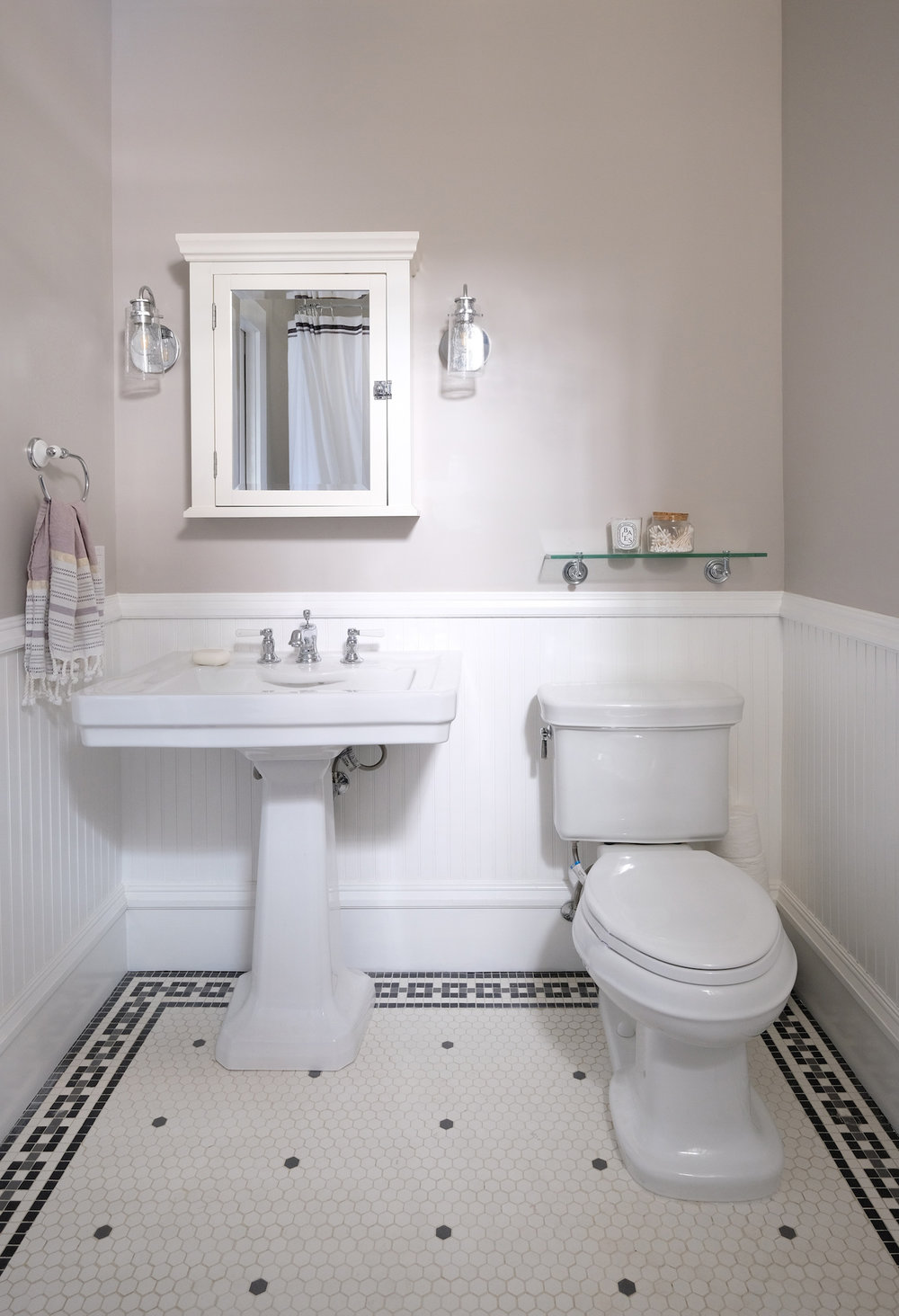 white bathroom with grey and white mosaic floor tile.jpg