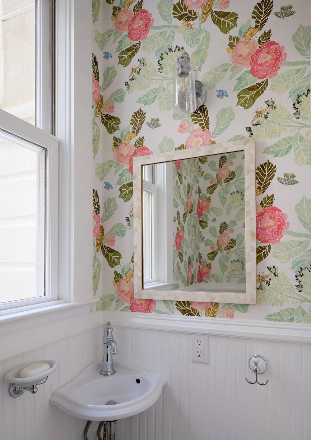 white powder room with floral wallpaper.jpg