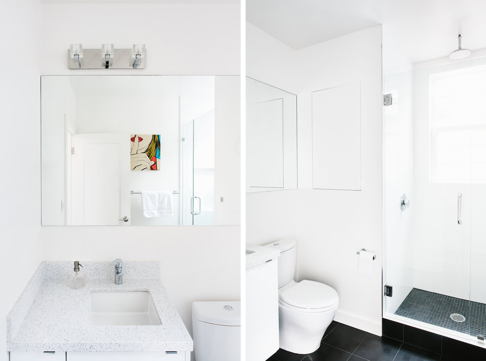white bathroom with black tile floor and corner vanity with granite counter and chrome fixtures.jpg