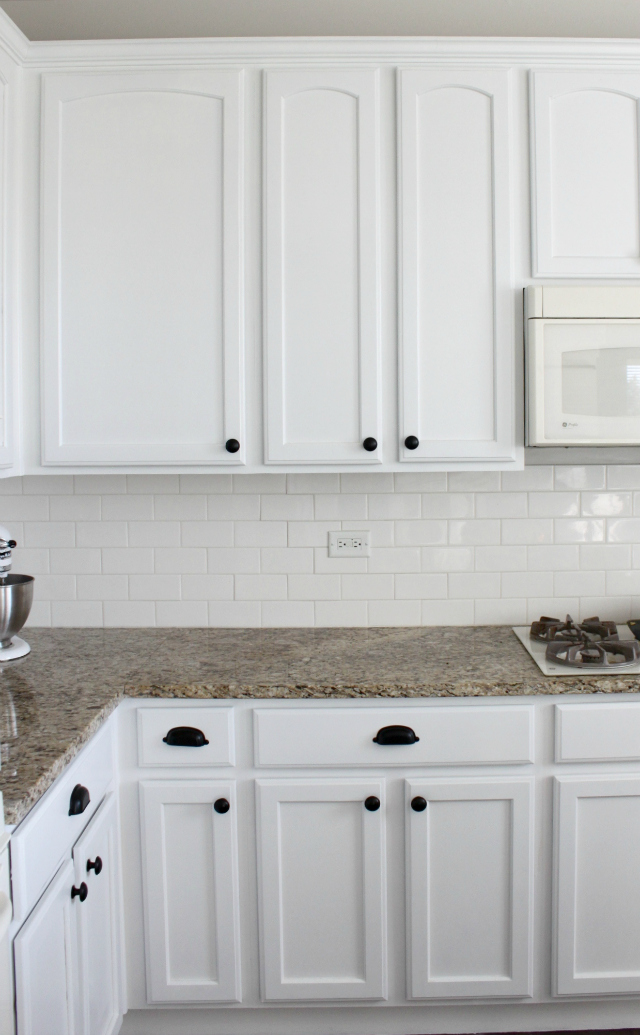 how to paint your kitchen cabinets white colors and craft rh colorsandcraft com how to paint your dark cabinets white how to paint your bathroom cabinets white