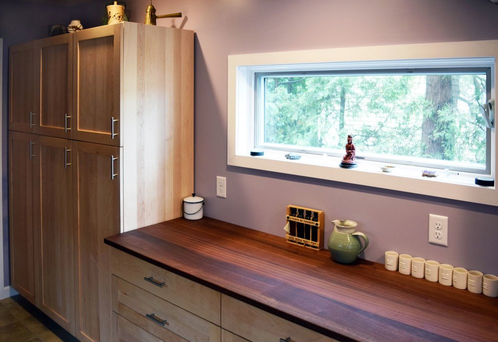 Photo of custom kitchen. Maple shaker style cabinetry with walnut countertop. Kitchen cabinetry design and renovation ideas.