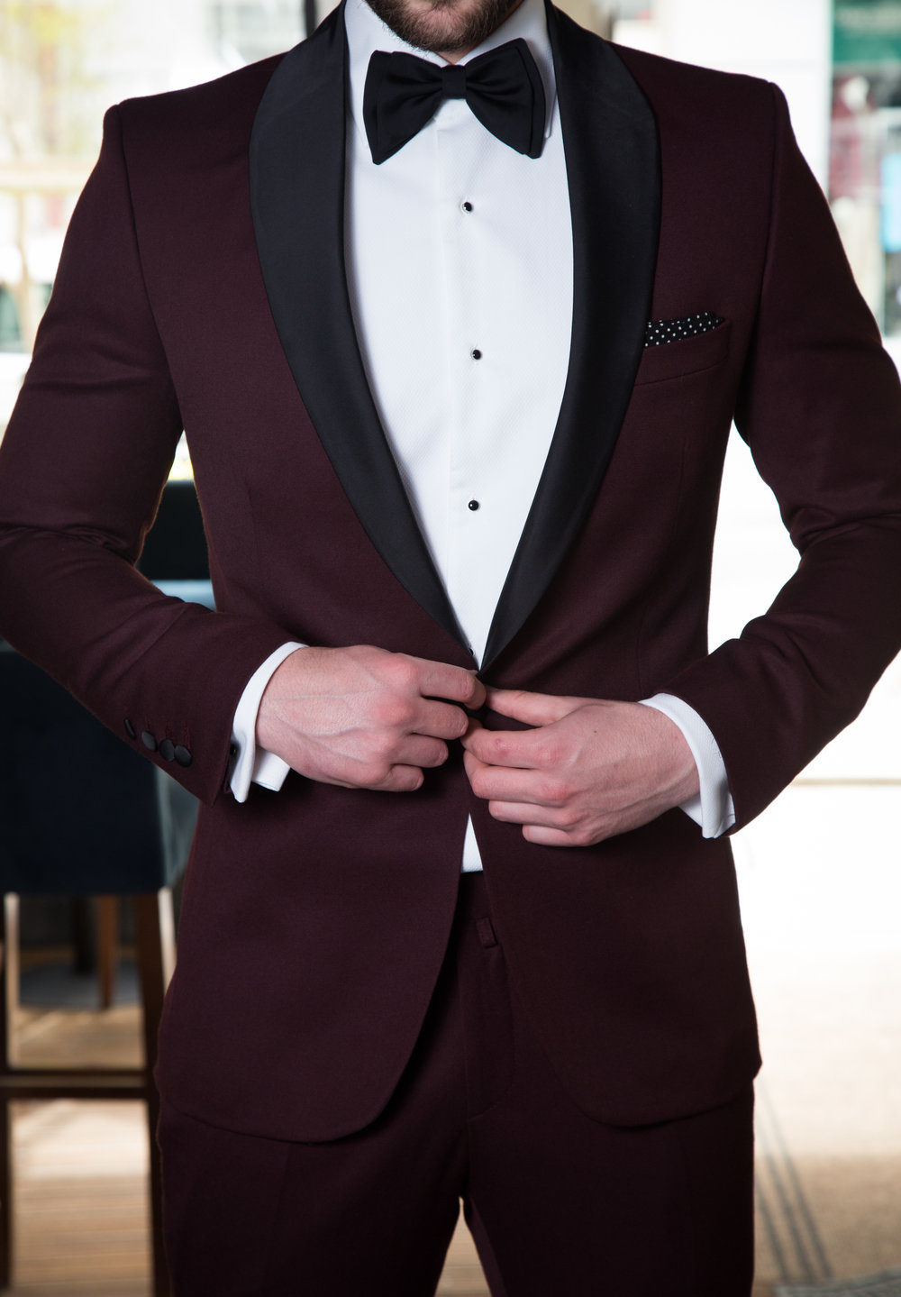 - 1. Always check the shoulders for a proper jacket fit, the seam should not be hanging off and it should work with your natural curves without excessive pulling or creasing when moving your arms.2. The lapels on the suit jacket and your shirt collar should line up without a significant collar gap. The gap usually means a jacket is too small and will stretch awkwardly when performing various activities.3. When accessorizing, make sure your pocket square is a different pattern/fabric than your tie, and be sure your tie is a darker color compared to the shirt you are pairing it with.4. The middle button of a three-button suit or the top button of a two-button suit should fall right around your navel, if not right at the spot than preferably higher.5. The width of your tie should match the width of your lapel, and while we are on the subject of ties, make sure the tip of your tie is at or just before the buckle of the belt.