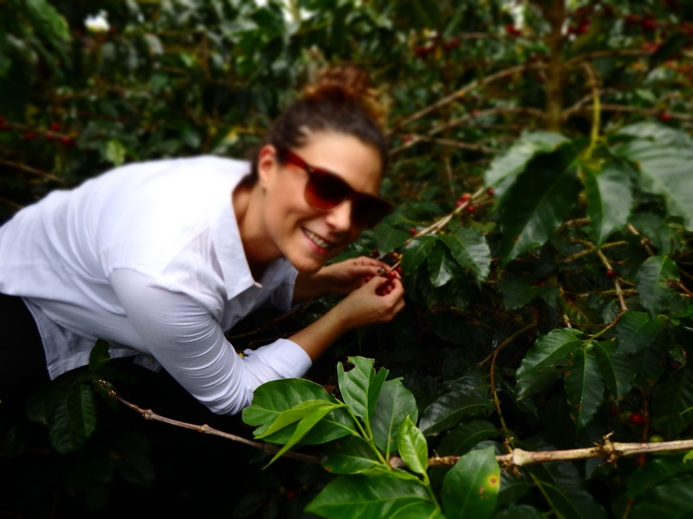 Owner, Alyza Bohbot, visits a woman's farm in Colombia.