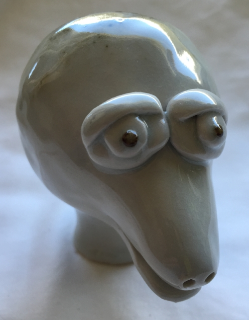 A creature from a period of time I was failing in high fire. Most of the work fired during this time was ruined due to incompatibility with the studio's clear glaze and the clay body being used.